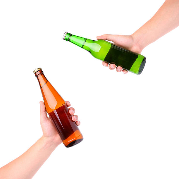 hands clinking glasses beer - gripping stock photos and pictures