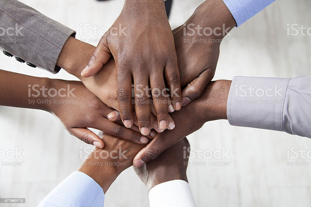 Hands Close Up on top of each other. stock photo