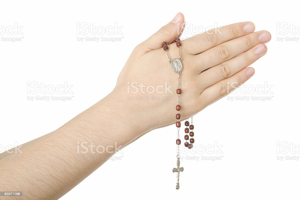Hands closed in prayer with a rosary royalty-free stock photo