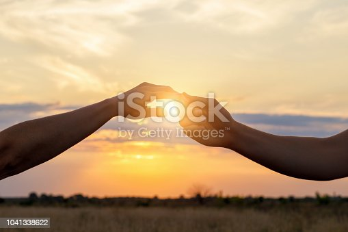 974882202 istock photo Hands contact each other . 1041338622