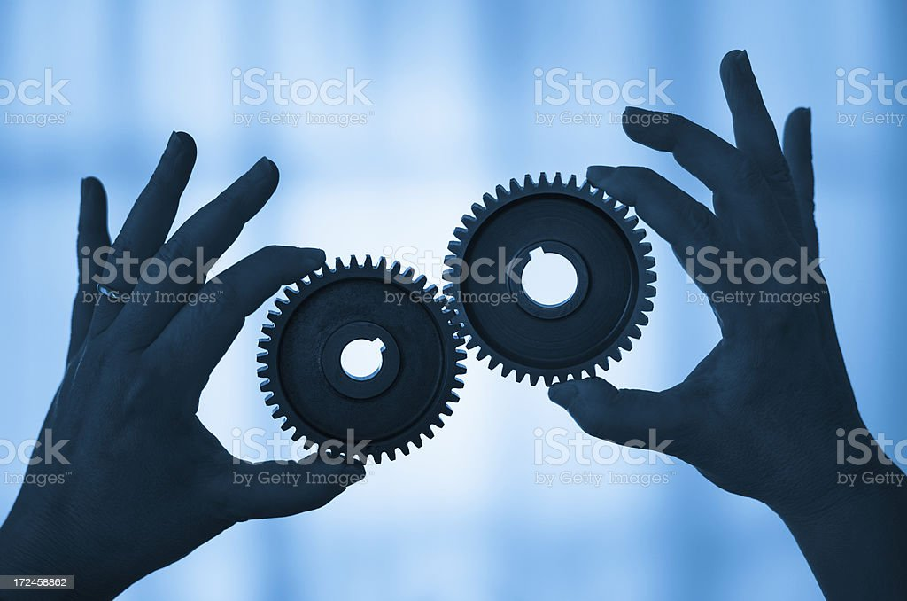Hands controlling Gear working togetherness stock photo