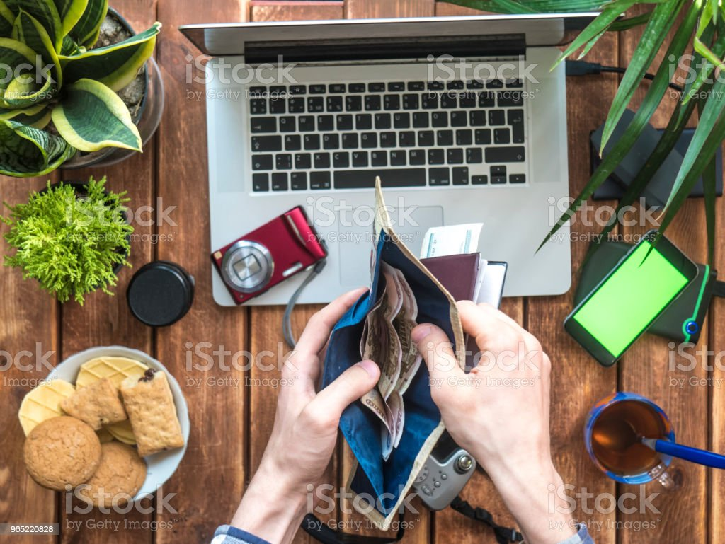 hands counting money in wallet over table with photo supplies zbiór zdjęć royalty-free