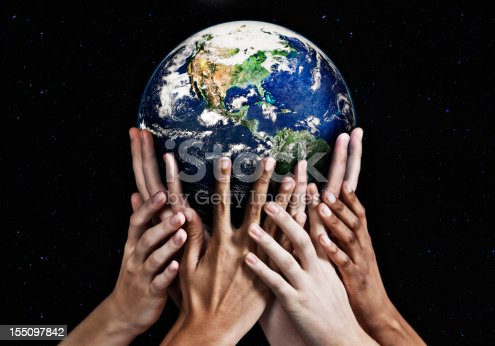 Hands cradle Mother Earth against a starfield background. Environmental awareness and an acceptance of responsibility for the care of our earthly home showing here.