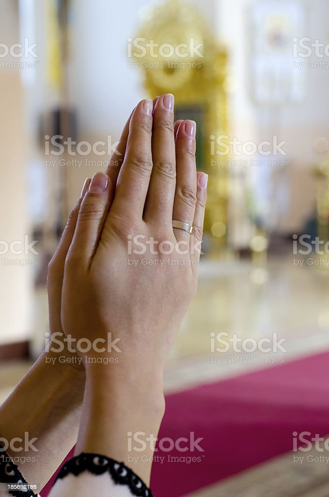 Hands crossed in prayer royalty-free stock photo
