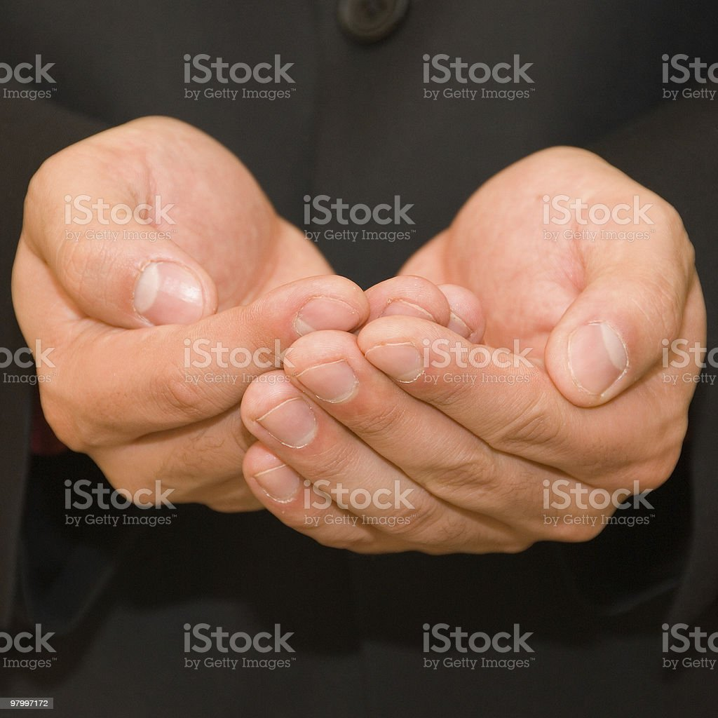 Hands cupped together aganst black suit royalty-free stock photo