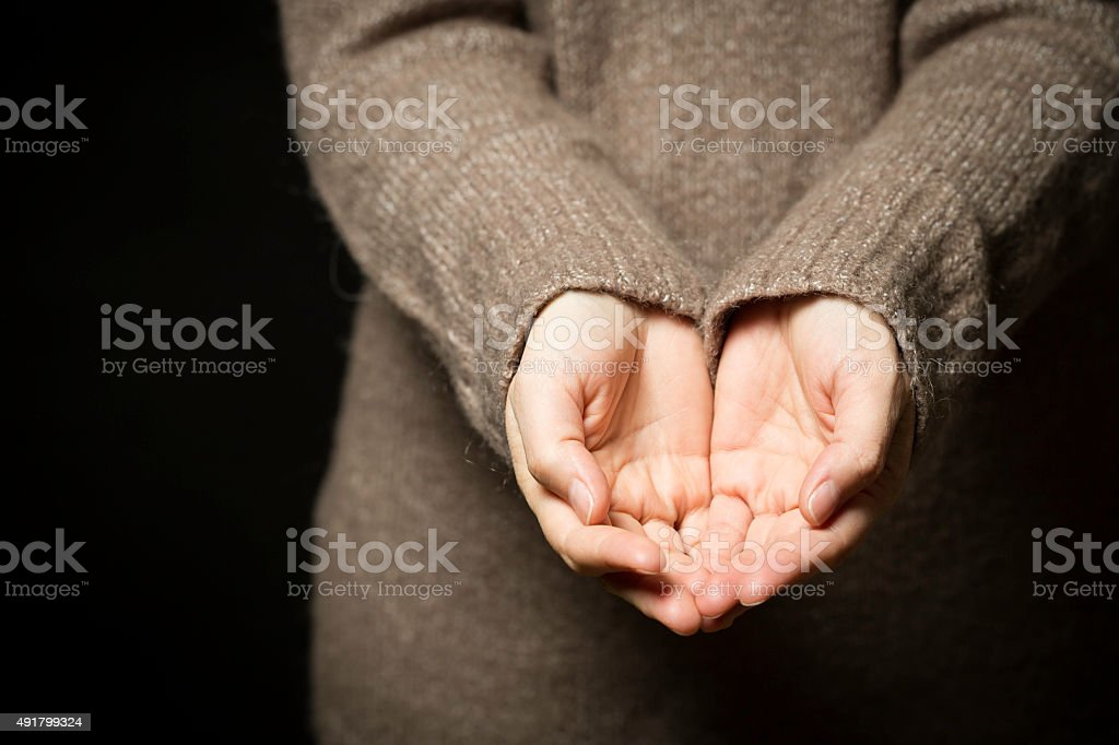 hands cupped together stock photo