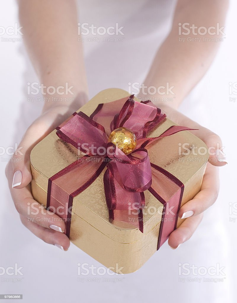 Hands Cupping Gift Box royalty-free stock photo