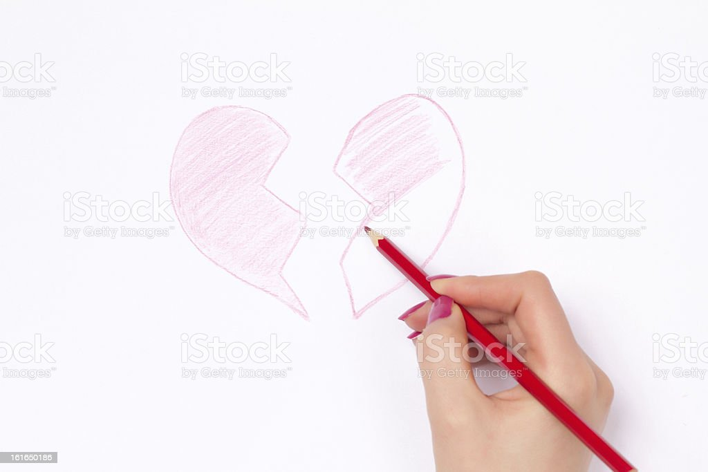 Hands, cut heart and pencil royalty-free stock photo