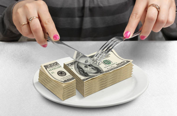 hands cut money on plate, reduce funds concept - cross section stock pictures, royalty-free photos & images