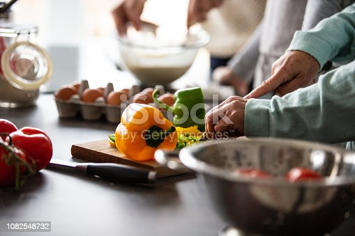 istock Hands cutting vegetables in the kitchen 1082548732