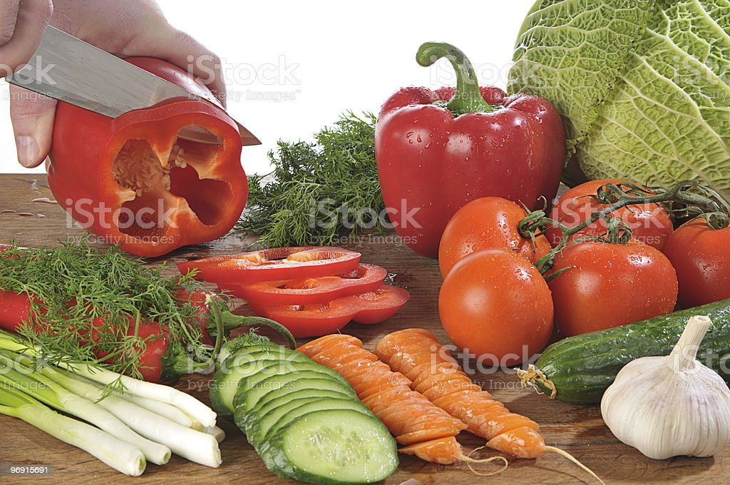 Hands cutting vegetables royalty-free stock photo