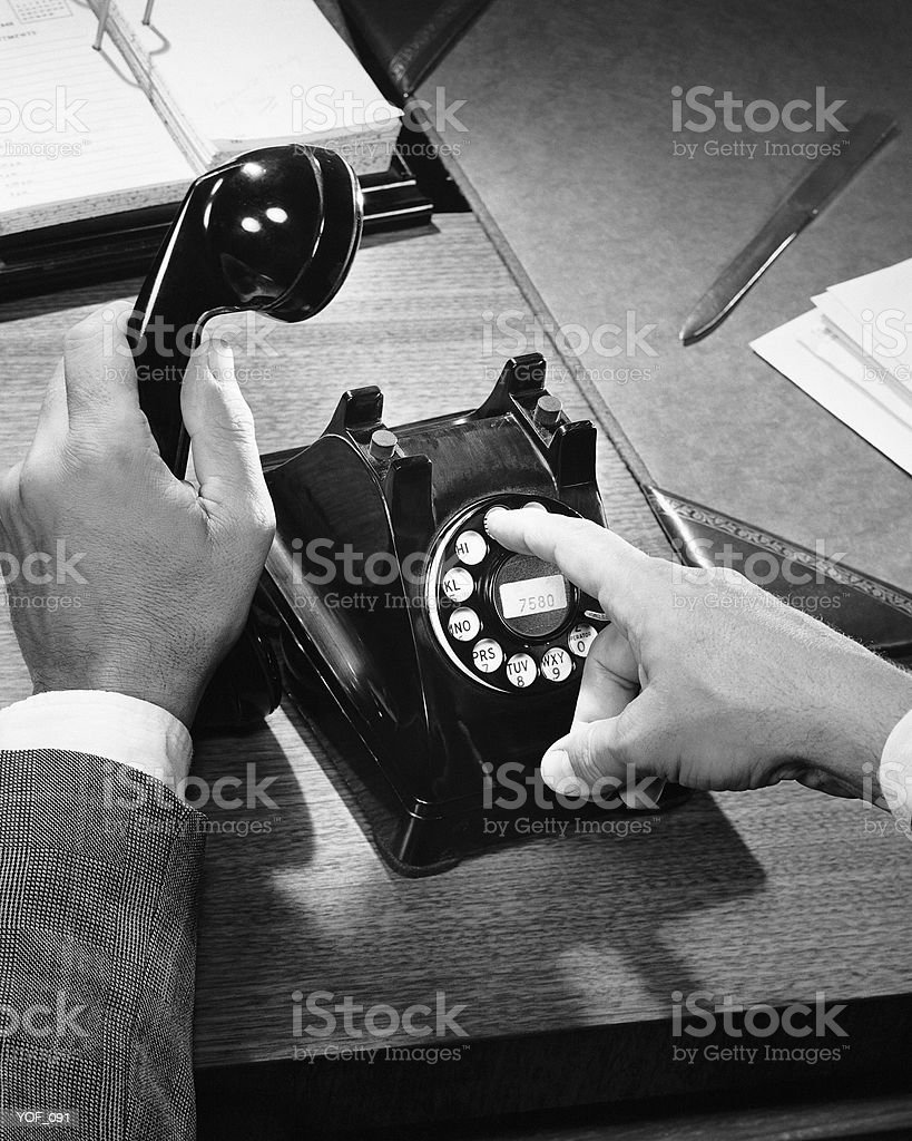 Hands dialing phone royalty free stockfoto