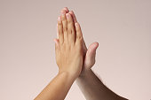 Hands doing hi-five. success and achievement concept. Teamwork.