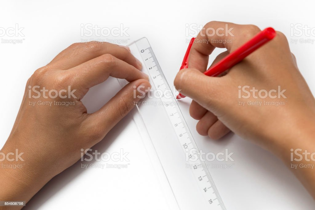Hands Drawing A Line Using Ruler stock photo