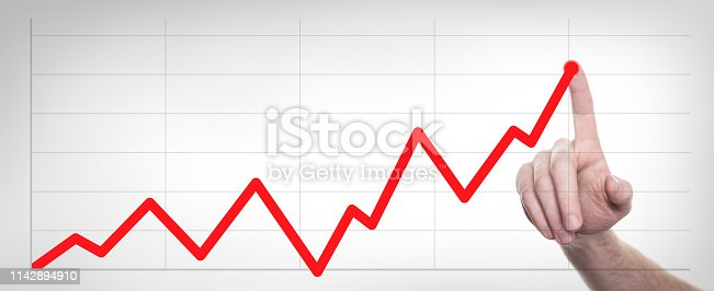 istock Hands drawing line chart and business strategy. 1142894910