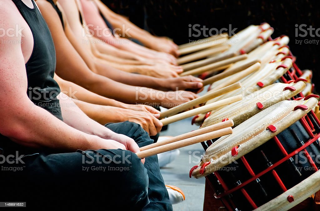 Hands, drum sticks and drums stock photo