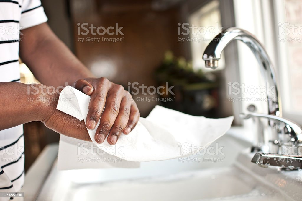 Hands Drying on Paper Cloth stock photo