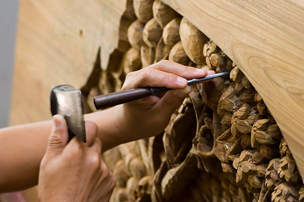 Hands engraving wood Hand with tool blured in motion carving craft product stock pictures, royalty-free photos & images