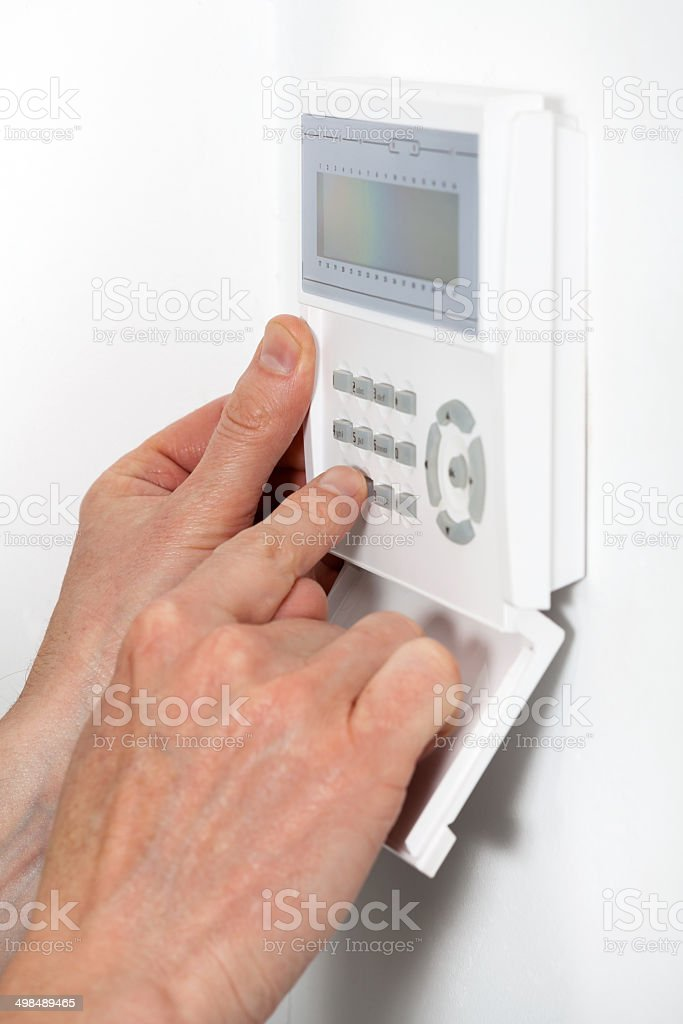 Hands entering a code stock photo