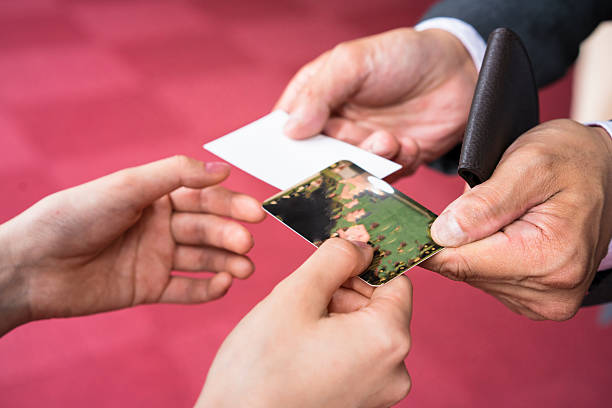 Exchanging business cards in japan choice image business card template royalty free business women exchanged business cards kyoto japan hands exchanging business cards in office hall colourmoves