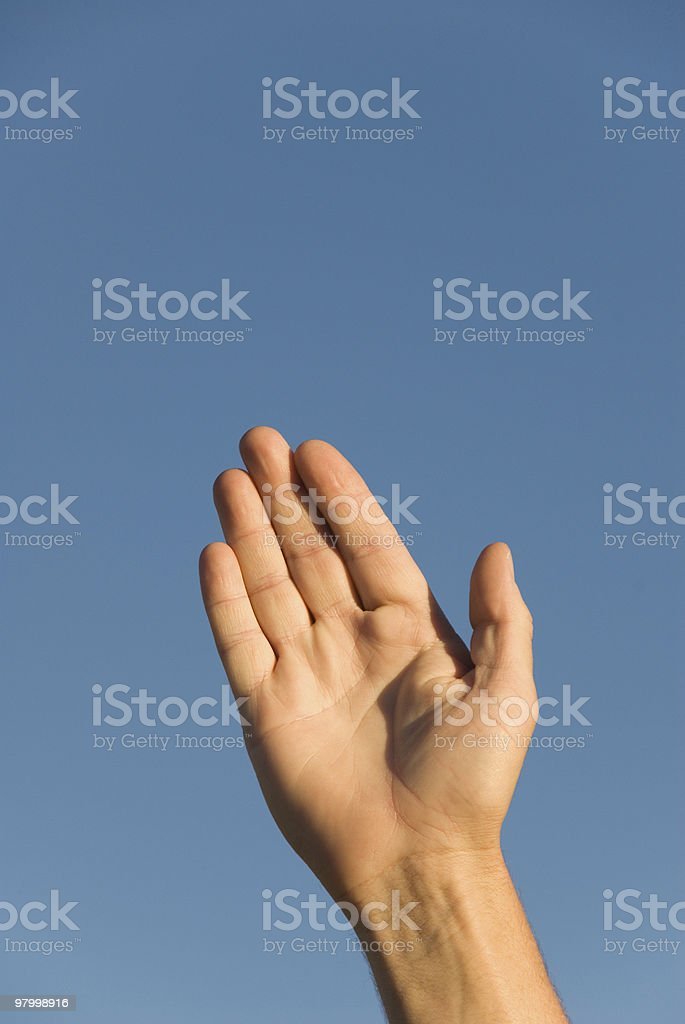 Hands extended upward aganst blue sky royalty free stockfoto