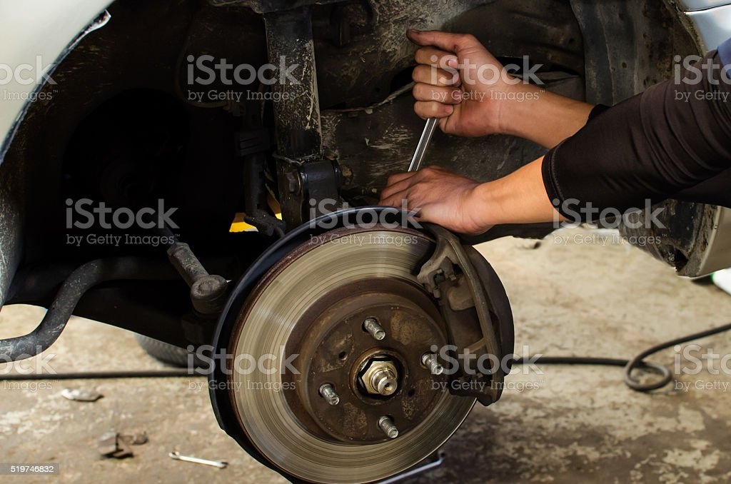 hands fixing disk brake mechanism car wheel hub stock photo
