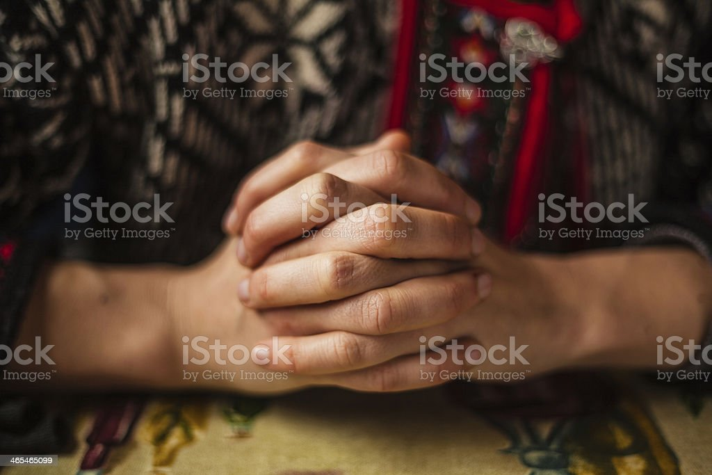 Hands folded stock photo