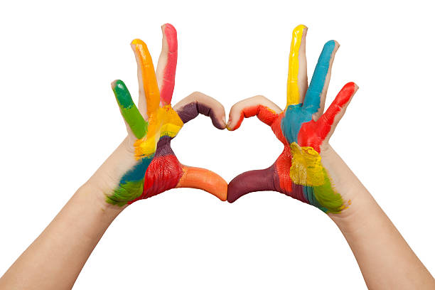 hands forming a heart shape painted in multiple colors - tempera painting stock pictures, royalty-free photos & images