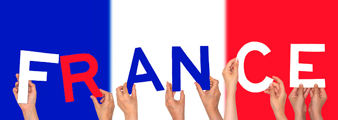 hands forming  France text with flag background