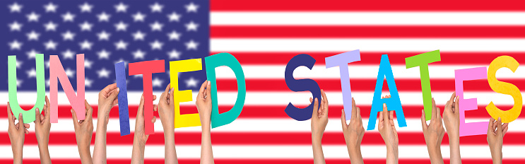 hands forming  United states text with flag background