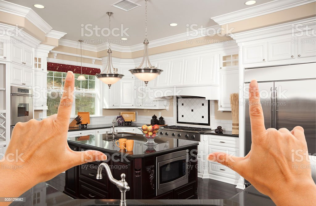 Hands Framing A Beautiful Custom Kitchen stock photo
