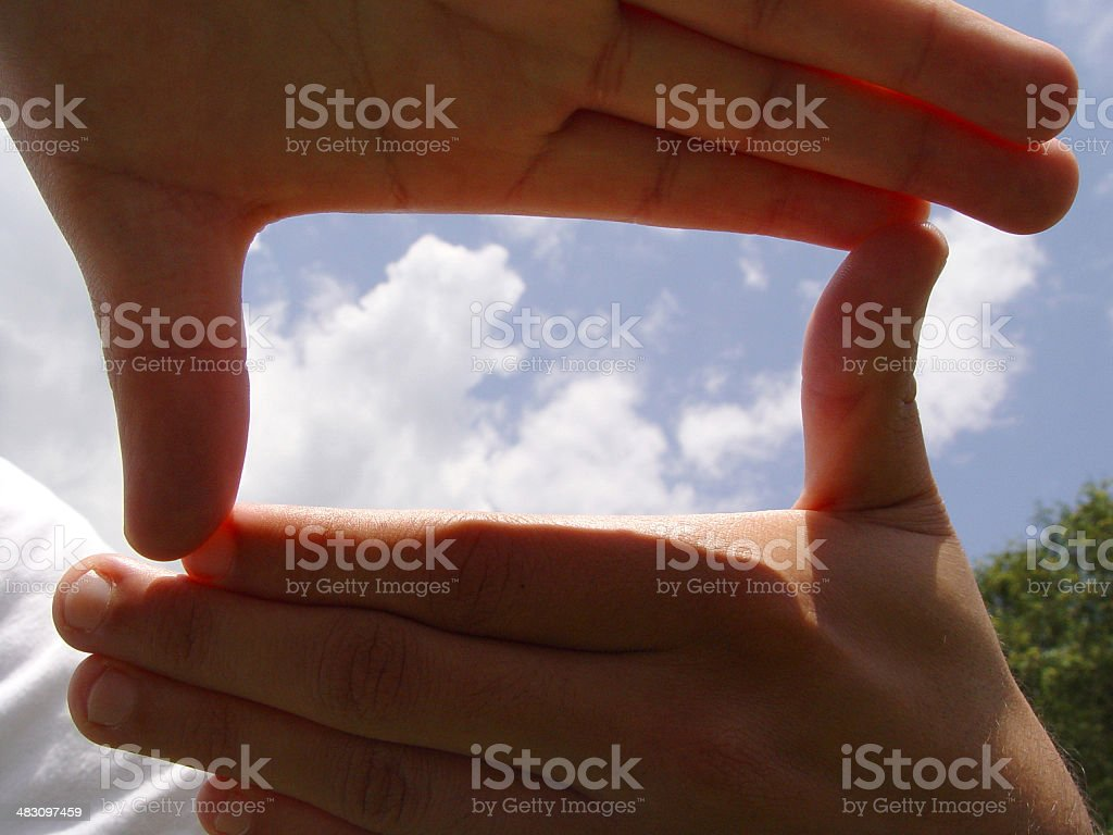 Hands framing sky royalty-free stock photo