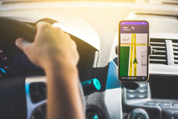 Hands Free Smart Phone in a car A person using a hands free phone clip whilst driving a car. global positioning system stock pictures, royalty-free photos & images
