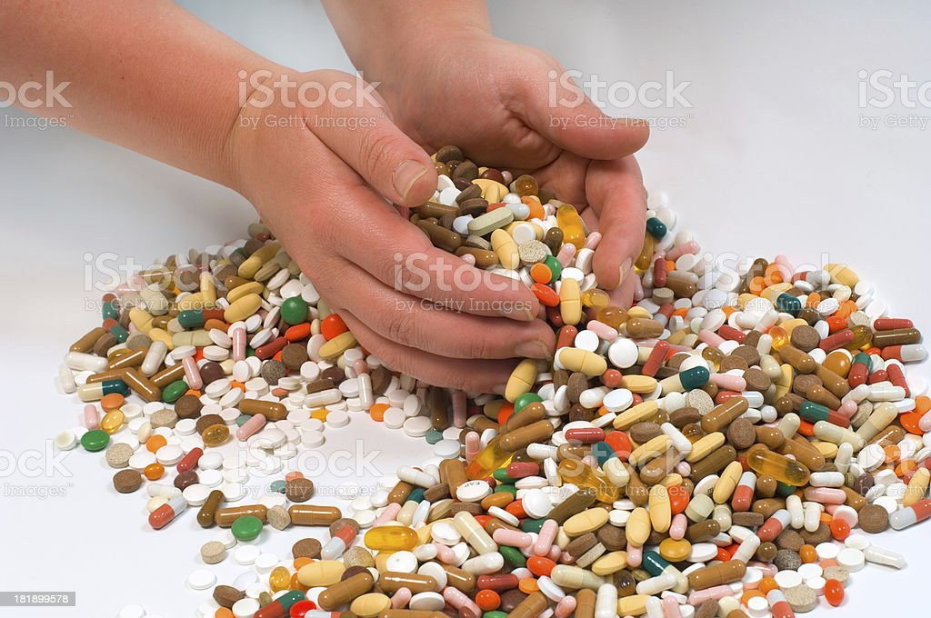 hands full of drugs royalty-free stock photo
