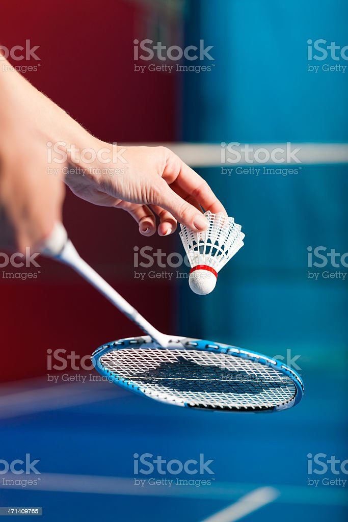 Hands getting ready to serve in a game of badminton stock photo