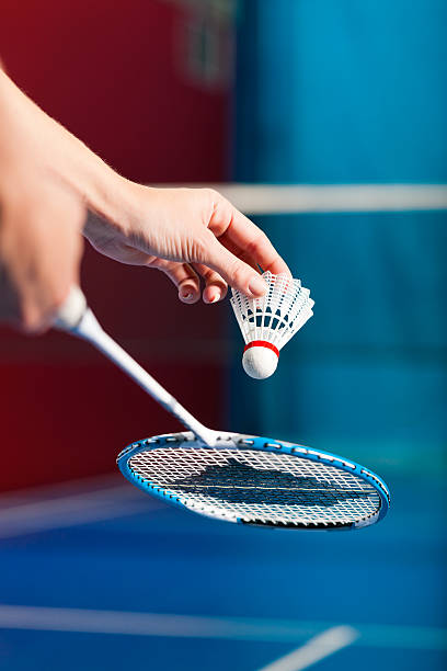 Hands getting ready to serve in a game of badminton Woman playing Badminton and doing sport in gym, only serve to be seen badminton stock pictures, royalty-free photos & images