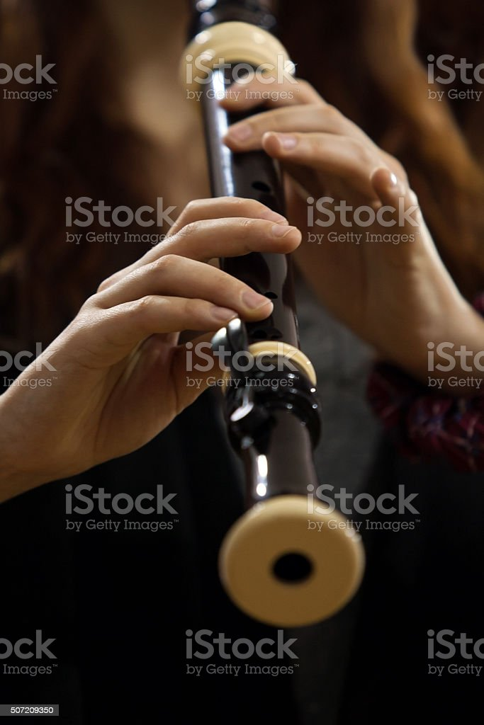 Hands girl playing of recorder stock photo