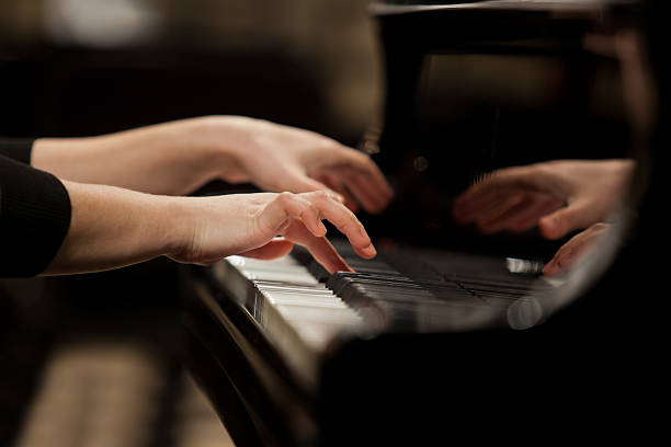 Hands girl playing piano Hands girl playing piano closeup pianist stock pictures, royalty-free photos & images