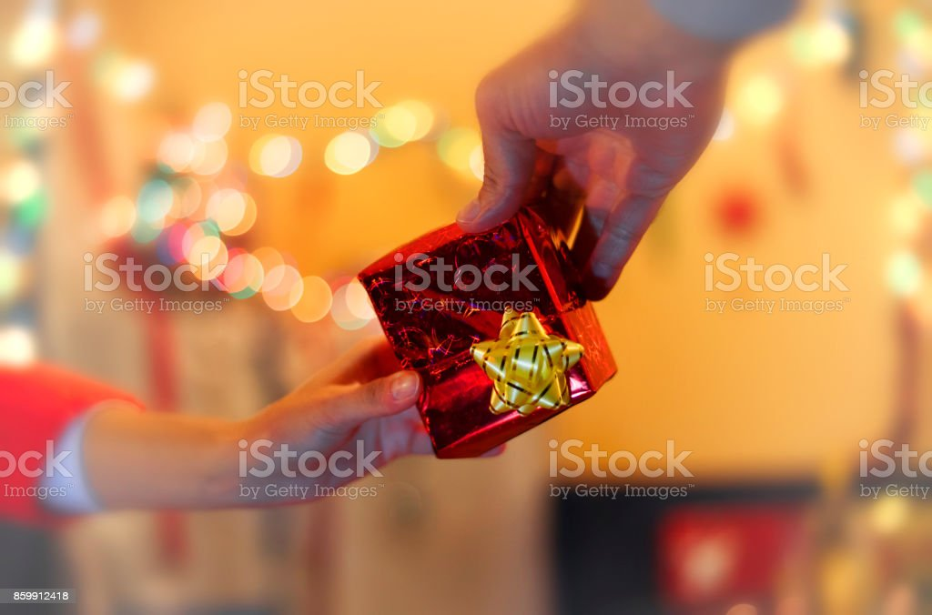 Hands give a Christmas gift stock photo