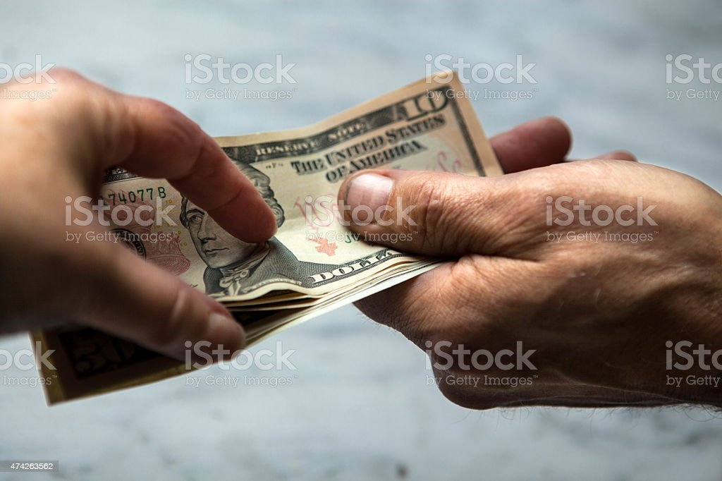 Hands giving and receiving money stock photo