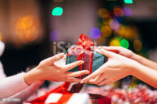 istock Hands Giving Gift Close-up 871610664