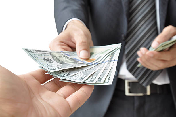 hands giving & receiving money - united states dollars (usd) - paid stock pictures, royalty-free photos & images