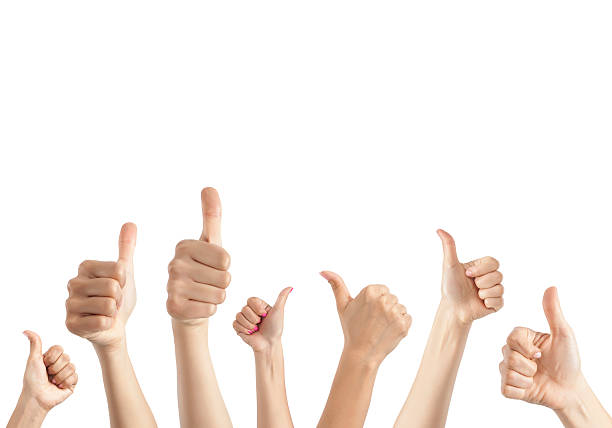 Hands giving thumbs up stock photo