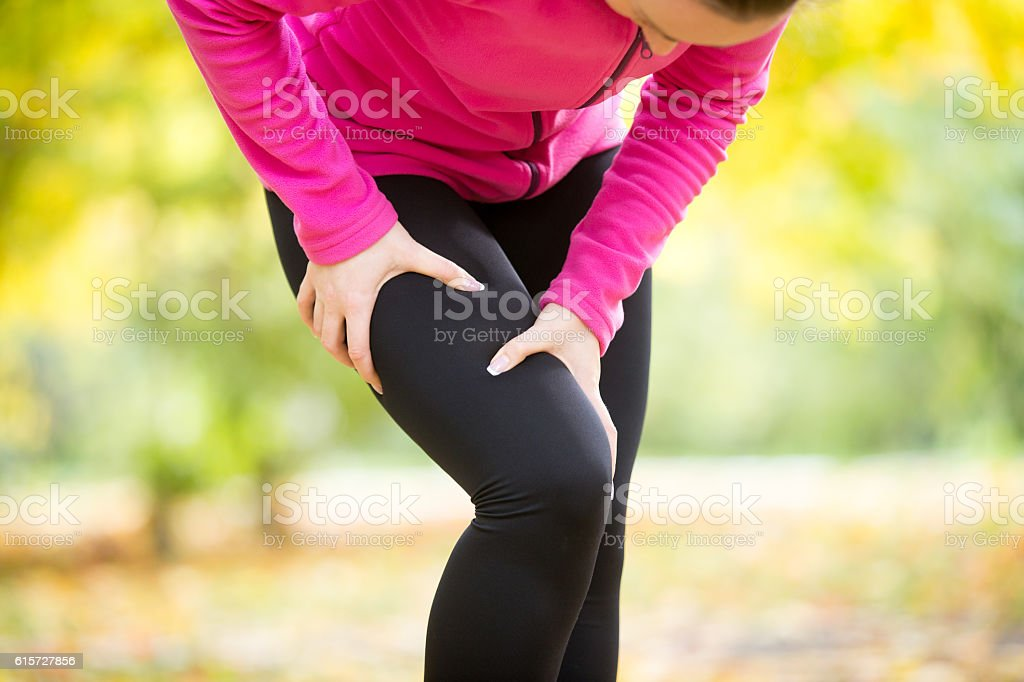 Hands grabbing a hip, sport injury stock photo