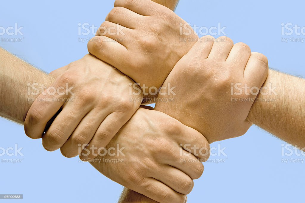 4 hands held in a square pattern royalty-free stock photo