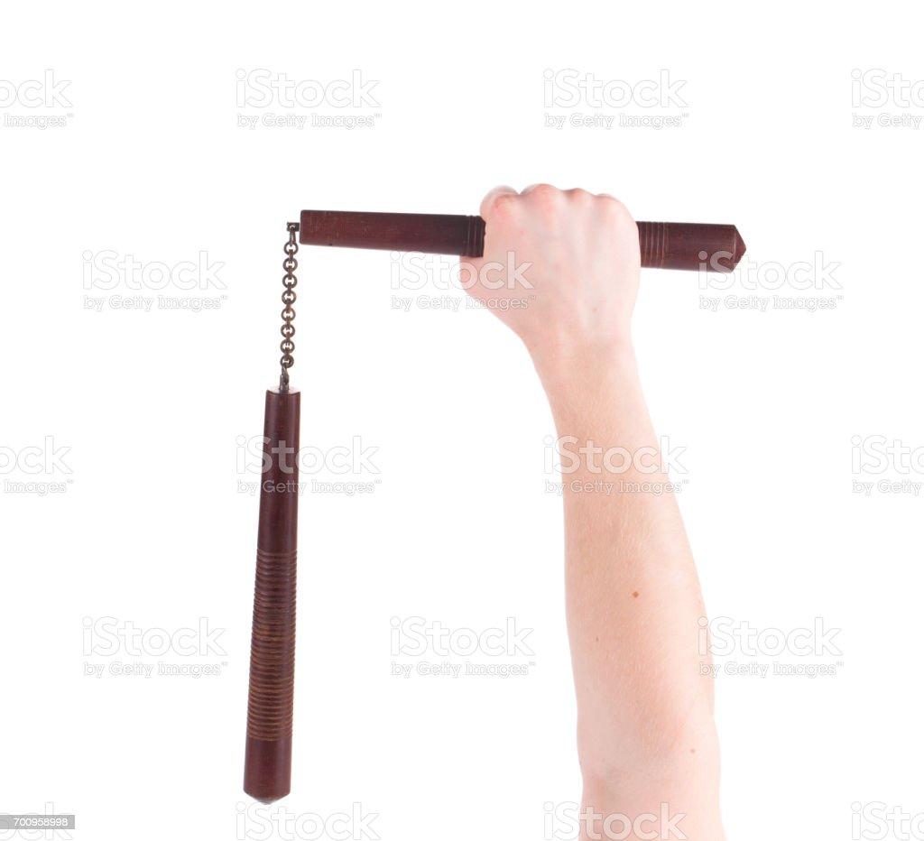 Hands hold martial arts nunchaku. stock photo