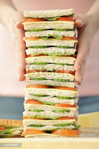The sandwich is stacked high