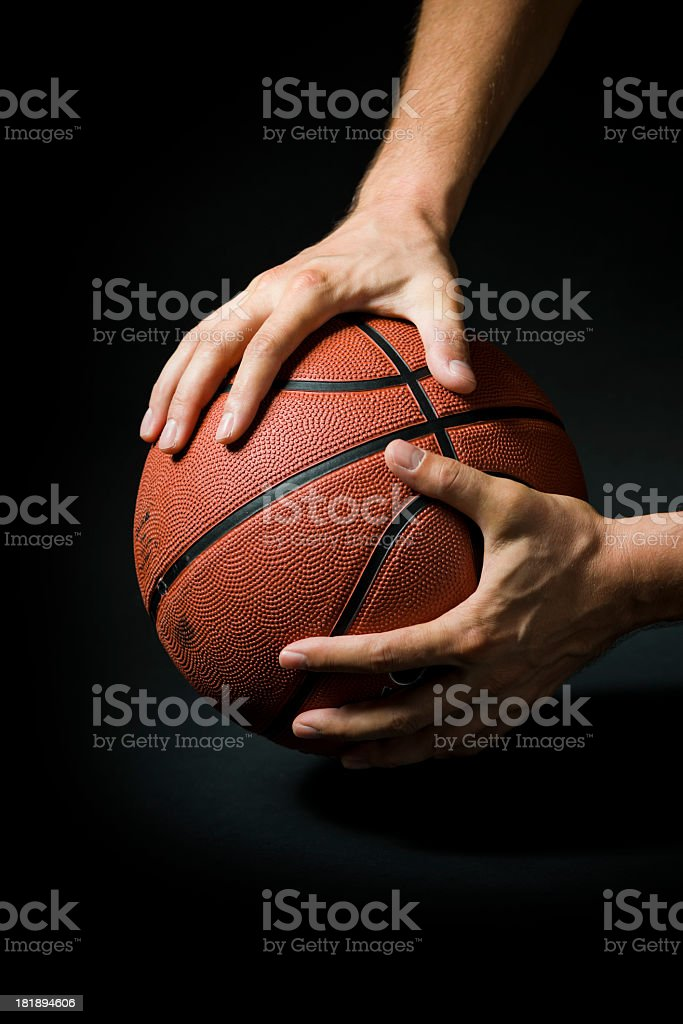 Hands holding a basketball stock photo