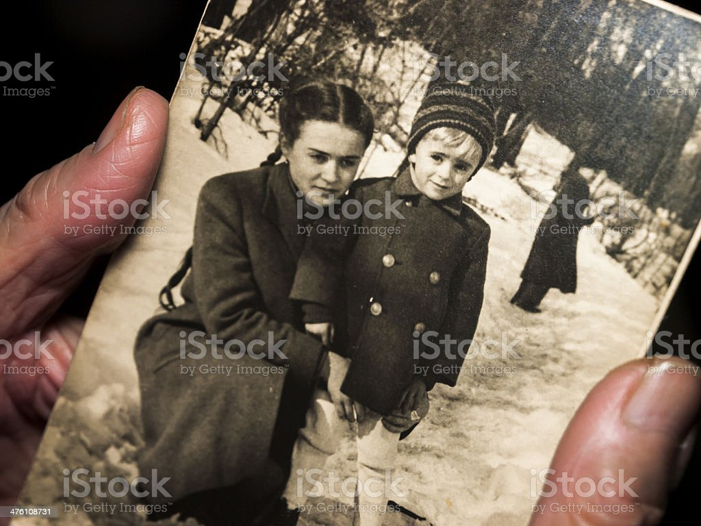 Hands holding a black and white family photograph stock photo