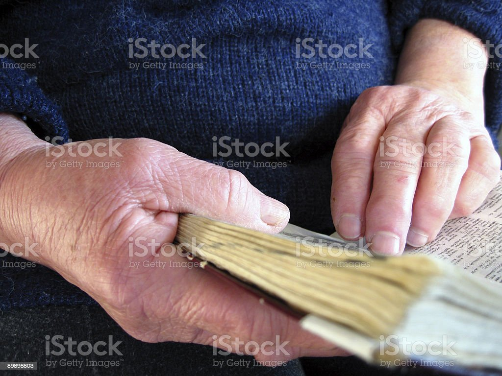 Hands holding a book royalty-free stock photo